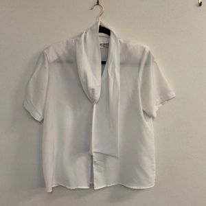 White silk blouse with tie collar
